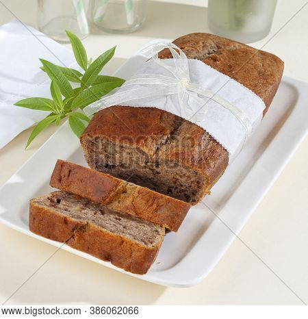 Moist And Delicious Banana Bread Slices Made With Ripe Bananas, Nuts, Butter, Sugar, Egg, Vanilla, B