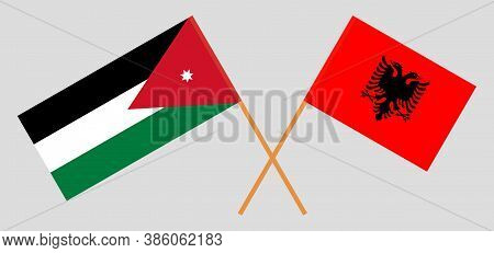 Crossed Flags Of Jordan And Albania. Official Colors. Correct Proportion. Vector Illustration