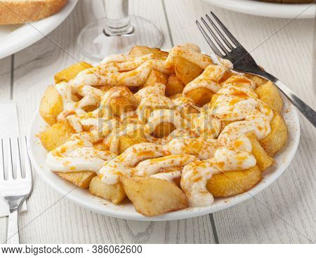 Spanish Tapas Food. Alioli Potatoes Served With Garlic Sauce And Paprika.