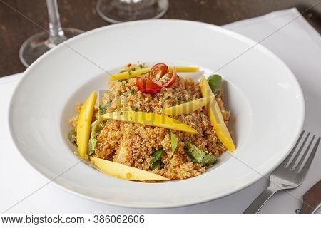 Quinoa Salad With Chicken And Mango Served At Restaurant.
