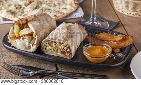 Indian Food. Chicken Tikka Wrap Sandwich With Sauce.