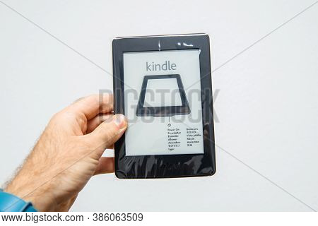 Paris, France - Mar 13, 2018: Male Hand Pov Personal Perspective Holding New Amazon Kindle E-reader
