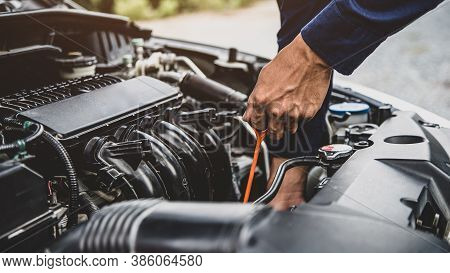 Auto Mechanic Are Checking Vehicle Engine Oil Level To Changing Car Engine Oil Concepts Of Maintenan