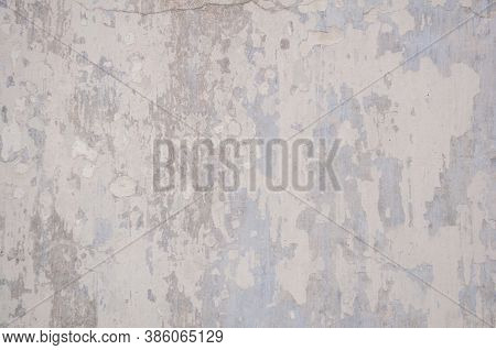Old Gray Wall Background. Peeling Paint. Stock Photo
