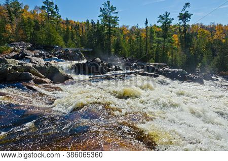 Cascading Water Over Rocks In Superior Lake Provincial Park, Canada
