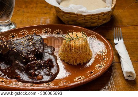 Mole, Typical Mexican Food. Served In Clay Plate On Wooden Table