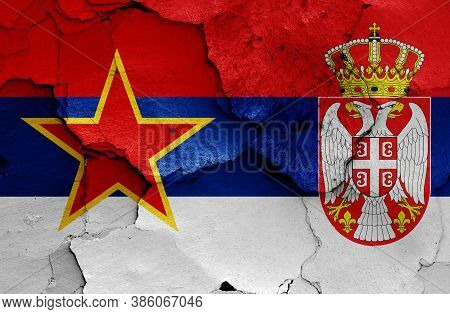 Historical Flag Of Socialist Republic Of Serbia And Today Serbia Flag On Cracked Wall