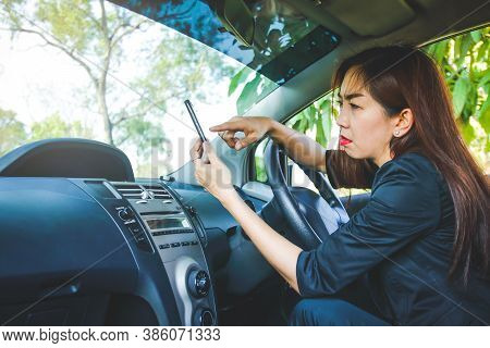 Woman Drove Astray In The Forest. Looking For A Solution But Without Internet Signal From The Phone