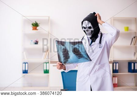 Male devil doctor radiologist working in the clinic
