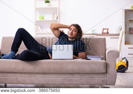 Young man employee working from house