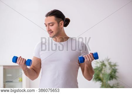 Young male starting day with morning exercises