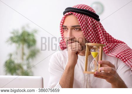 Young male arab employee working in the office