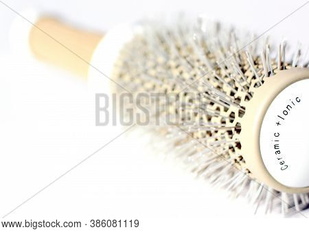 Brushing Comb For Styling And Straightening Hair. Professional Tool For A Hairdresser Stylist.