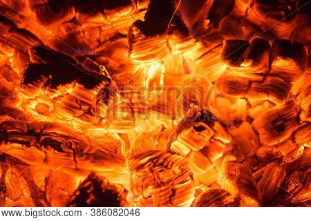 Smoldering Embers Of Fire. Hot Sparking Live-coals Burning In A Barbecue.