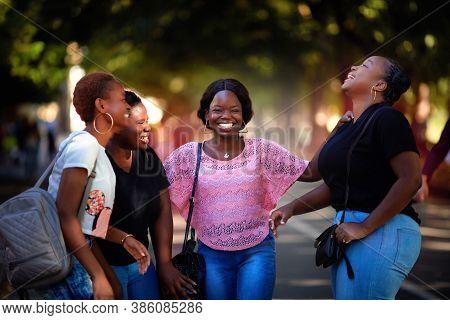 Beautiful African American Women, Laughing Friends Having Fun While Walking In The Park