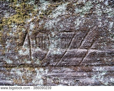 The Year 1974 Engraved Into The Sandstone Rock. Someone  Engraved Modern Numbers Rocky Wall In Sands
