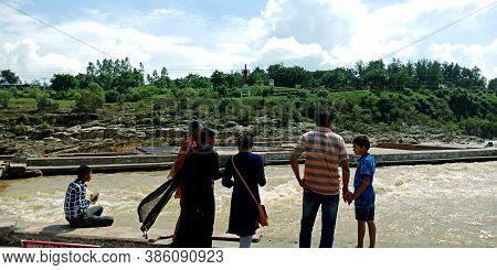City Jabalpur, India - August 18, 2019: Indian Family Enjoying At Narmada River In Bhedaghat Around