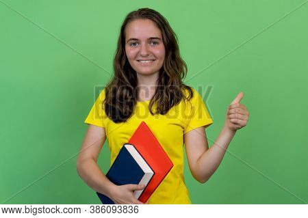 Successful German Female Student Showing Thumb Up Isolated On Green Background