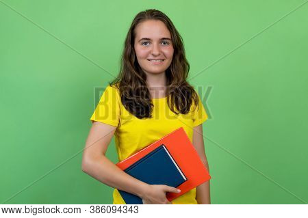 Beautiful German Female Student Isolated On Green Background