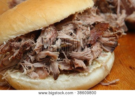 Pulled pork in a soft white bread roll