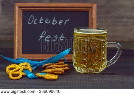 October Fest Concept. Beer Mug With Snacks Of Salt Pritzels, Bretzel And Board With The Words