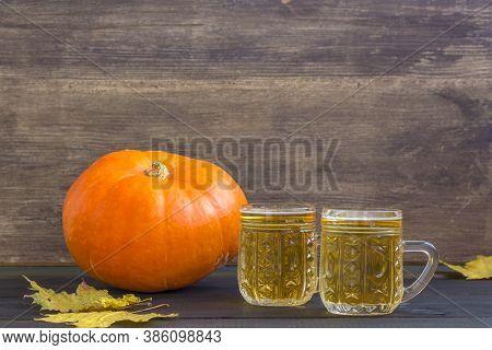 October Fest Concept. Beer Mugs With Snacks Of Salt Pritzels, Bretzel And Orange Pumpkin On Dark Woo