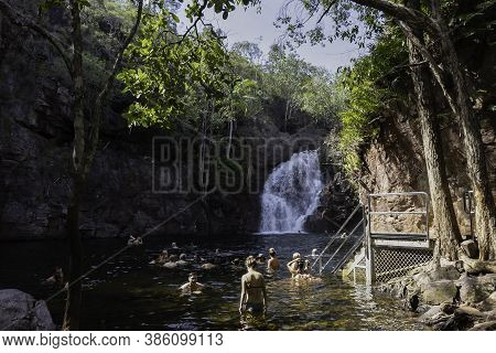 Florence Falls, Australia - March 15th, 2020: Tourists Bathing In The Plunge Pool At The Bottom Of F