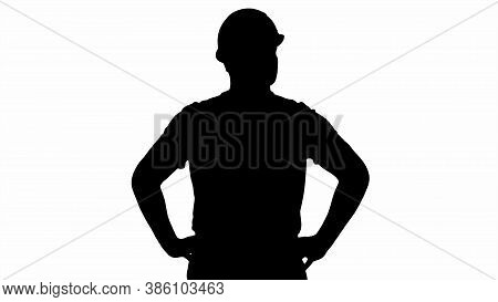 Silhouette Engineer In Construction Helmet Standing With Hands O
