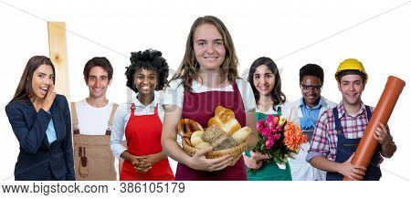 Laughing Female Baker With Group Of International Apprentices Isolated On White Background For Cut O