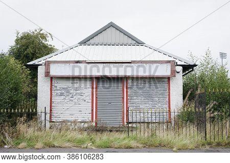Derelict Abandoned Shop Business In Poor Housing Crisis Ghetto Estate Slum Paisley