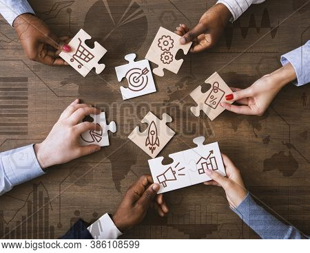 Creative Collage With Business People Holding Puzzle Pieces With Marketing Strategy Icons And Layere