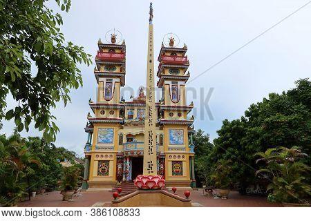 Hoi An, Vietnam, September 20, 2020: Colorful Taoist Cao Dai Temple. Hoi An, Vietnam