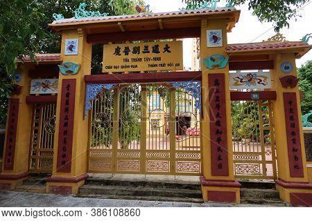 Hoi An, Vietnam, September 20, 2020: Entrance Gate To The Cao Dai Taoist Temple Compound. Hoi An, Vi