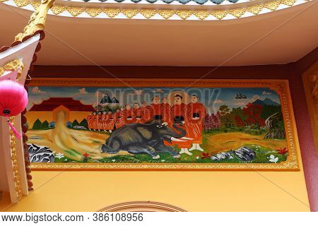 Hoi An, Vietnam, September 20, 2020: Mural With Monks Healing An Elephant On The Side Facade Of The