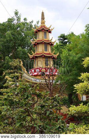 Hoi An, Vietnam, September 20, 2020: Pagoda In The Garden Of Tinh Xá Ngoc Cam Temple. Hoi An, Vietna