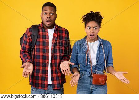 Travel Cancellation. Shocked African American Travelers Couple Looking At Camera Having Problems Wit