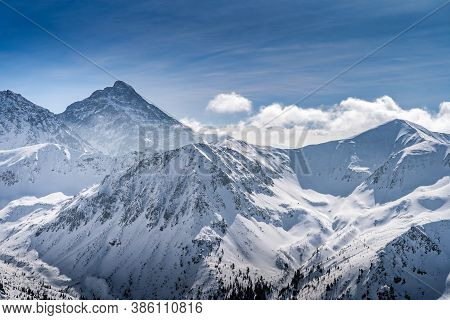 View From Kasprowy Wierch At Swinica Mountain Peak At Winter. Amazing Mountain Range With Snow Cappe