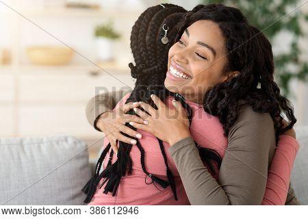Beautiful Black Women Hugging Her Friend, Home Interior, Empty Space