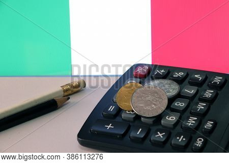 Heap Of Italy Coins On Calculator And Pencil On White Floor With Italia Flag Background, Repvbblica