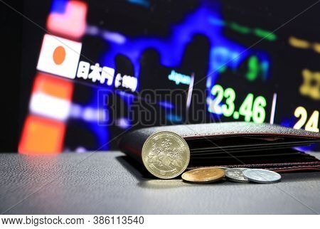 Japanese Five Hundred Yen Coins On Obverse (jpy) And Pile Of Other Japanese Coins On Black Floor Wit