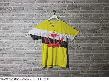 Brunei Darussalam Flag On Shirt And Hanging On The Wall With Brick Pattern Wallpaper, Red Crest On Y