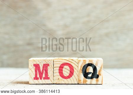 Alphabet Letter Block In Word Moq (abbreviation Of Minimum Order Quantity) On Wood Background