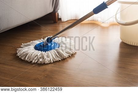 Mop Cleaning On Wooden Floor In House