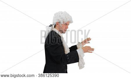 Man Dressed Like Mozart Conducting While Walking On White Backgr