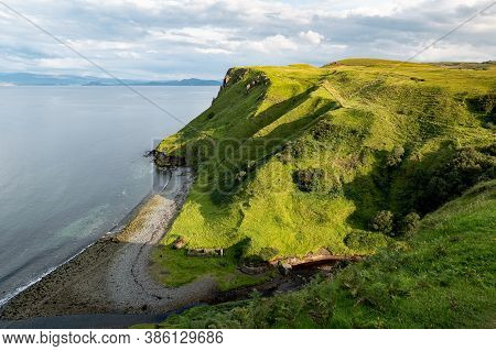 Scottish Landscape With Hills And Shoreline Near Staffin At Isle Of Skye Near The Ruins Of Old Diato