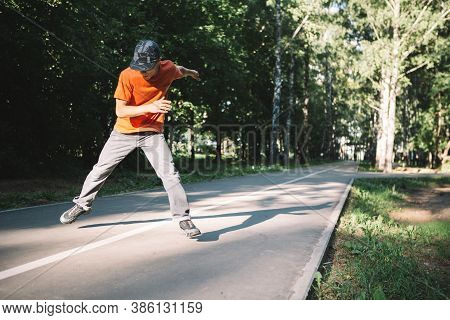 Cool Young Guy Dancing On The Road In Park In Summertime. Breakdancing School Poster