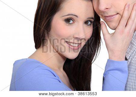 Woman caressing a man's face
