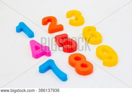 Kids Plastic Numeral On White Background. Study Counting With Fridge Magnets. Education In Preschool