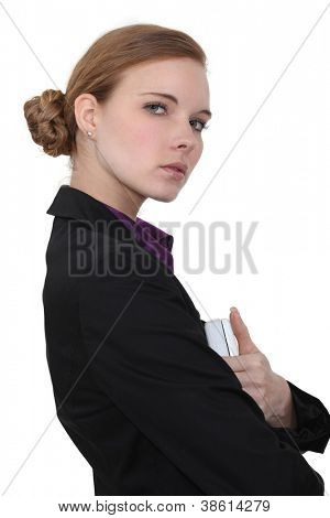 Portrait of an austere businesswoman poster