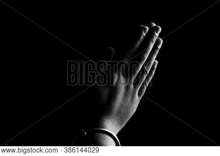 Praying Hands With Faith In Religion And Belief In God On Dark Background. Power Of Hope Or Love And